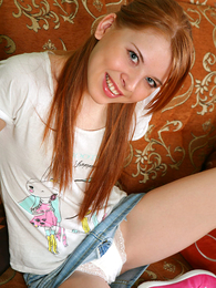 Teen redhead tugs essentially panties showing her cameltoe