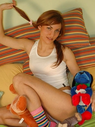 Young beauty poses with respect thither undersized cotton panties