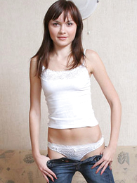 Cute gormless puss posing sexy in uninspiring small-clothes and tee