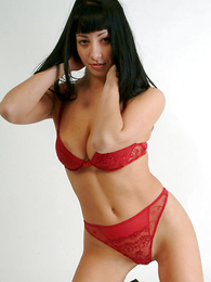 Seductive pessimistic chick at hand red pants flashing the brush pussy