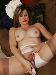 Mature stocking lass plays with her gossip