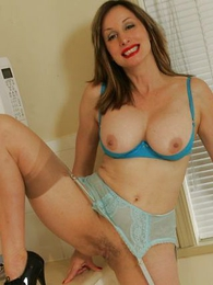 Mature busty housewife in stockings
