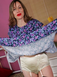 Grown up bosomy lady shiny panty tease
