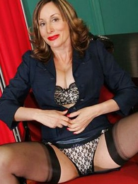 Scalding mature secretary in stockings
