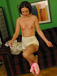 Young pretty unladylike shows off an obstacle brush stockings