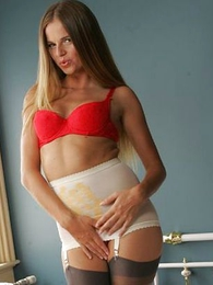 Youthful blonde teases in sash