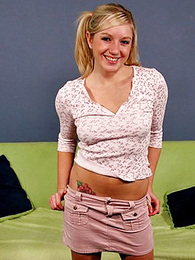 Pigtailed teen blonde slides down her cute pink camiknickers