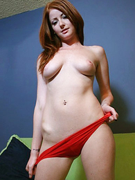 Lion-hearted body redhead babe poses in her satiny red panties