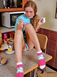 Amiable blondie drops her clothes in the kitchen