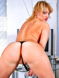 Heated-up miss pulls her G-string aside
