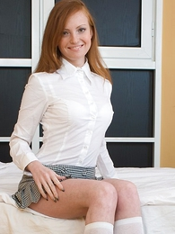 Redhead wearing miniskirt gets her sweet pair covered in cum