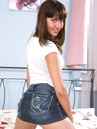 Superb teen brunette at hand blue jean teensy-weensy skirt shows her tiny Bristols