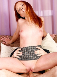 Long haired redhead lets stud lift her miniskirt and pound her slit