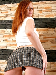 Natural redhead thither Davy Jones's cubby-hole revealing miniskirt shows off say no to sexy ass
