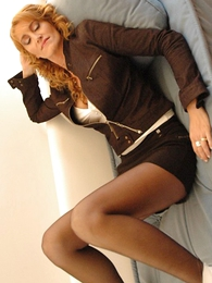 Beamy tit redhead yon midget skirt and pantyhose shows lacking her hot body
