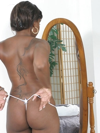 Pretty ebony putting on some of their way cute panties and moves them aside to rub their way wet pussy