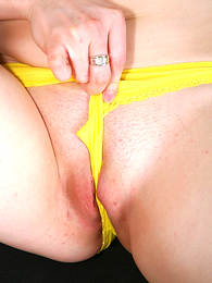 Undies photos - Charming young temptress in bright yellow panties