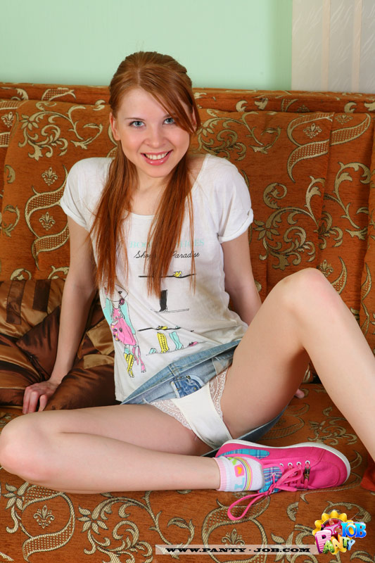 Teen redhead tugs on panties showing her cameltoe