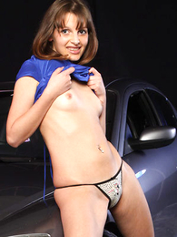 Panty photos - Girl makes her panties cut into her shaven snatch