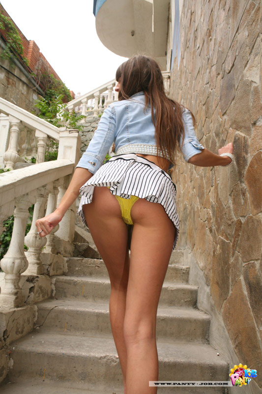 Leggy teen flashes her little panties outdoors