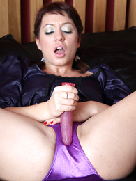 Thongs pics - Renee playing with toy on silk sheets