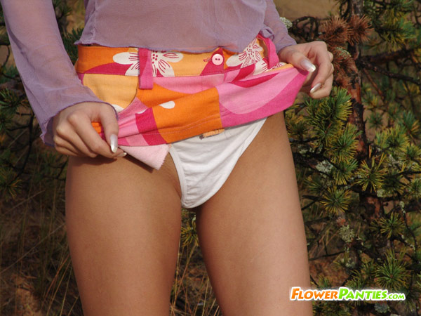 Blonde teen showing hold together outdoor