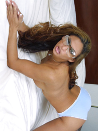 Panty pictures - Hot coal-black bitchie pulls her blue panties aside