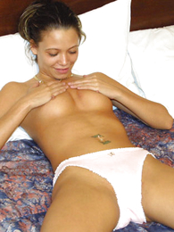 Undies pictures - Young newborn pulls panties aside showing her snatch