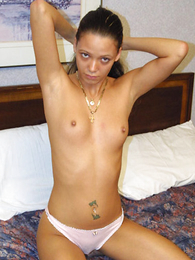 Teen in panties photos - Young newborn pulls panties aside showing her snatch