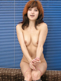 Undies photos - Raunchy redhair girlie poses yon confining pink Y-fronts