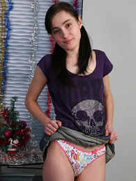 Panty gals - Infant lifts skirt to show her colorful panties - Picture #1