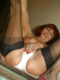 Undies pictures - Mature slut with respect to stockings on stairs