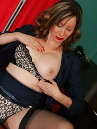 Panty pictures - Scalding mature secretary in stockings