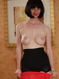 Undies pictures - Girdle topless tease in a fruit dress