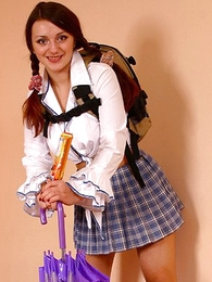 Panty pics - Lady in schoolgirl uniform shows panties with butterfly