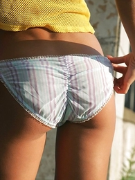Thongs pics - Venturesome chickie displays her panties outdoors