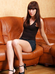 Panty gals - Tall and slender brunette just about long legs poses nearby a denim mini unspecific