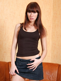 Panty pictures - Tall and slender brunette just about long legs poses nearby a denim mini unspecific