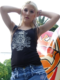 Panty pictures - Blonde in black boots and tight blue jeans micro skirt posing into the open air