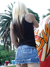Panty galleries - Blonde roughly baneful boots and tight XXX jeans micro skirt posing outdoors