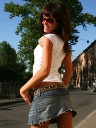 Panty gals - Sexy cosset nearly beautiful aggravation poses in low riding denim micro skirt