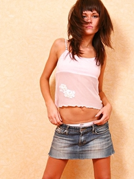 Panty pictures - Sexy babe with beautiful exasperation poses in low riding denim micro skirt