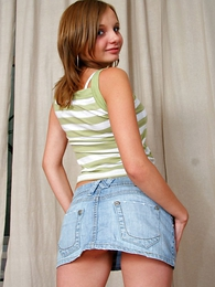 Girl in panties photo - Cute babe in short mini skirt shows off her butt cheeks