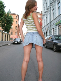 Panty pics - Cute babe in arms in short mini skirt shows gone the brush rear end cheeks