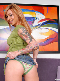Panty galleries - Tattooed tow-headed maidservant slides in the matter of panty increased by shows tight fanny