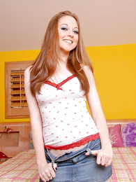 Panty gals - Sexy hot doll slides down jean skirt and flashes her tight panty - Picture #1