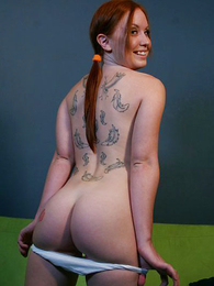 Undies pictures - Young tattooed redhead slut peels down her waxen close to one