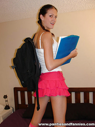 Panty gals - Pigtailed thin brunette shows off their way tiny pink thong panties - Picture #1
