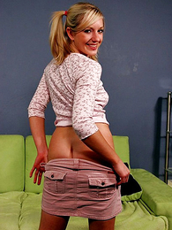 Panty photos - Pigtailed teen blonde slides down her cute pink camiknickers
