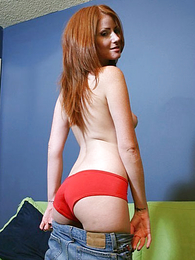Panty pictures - Strong body redhead babe poses in her satiny red panties
